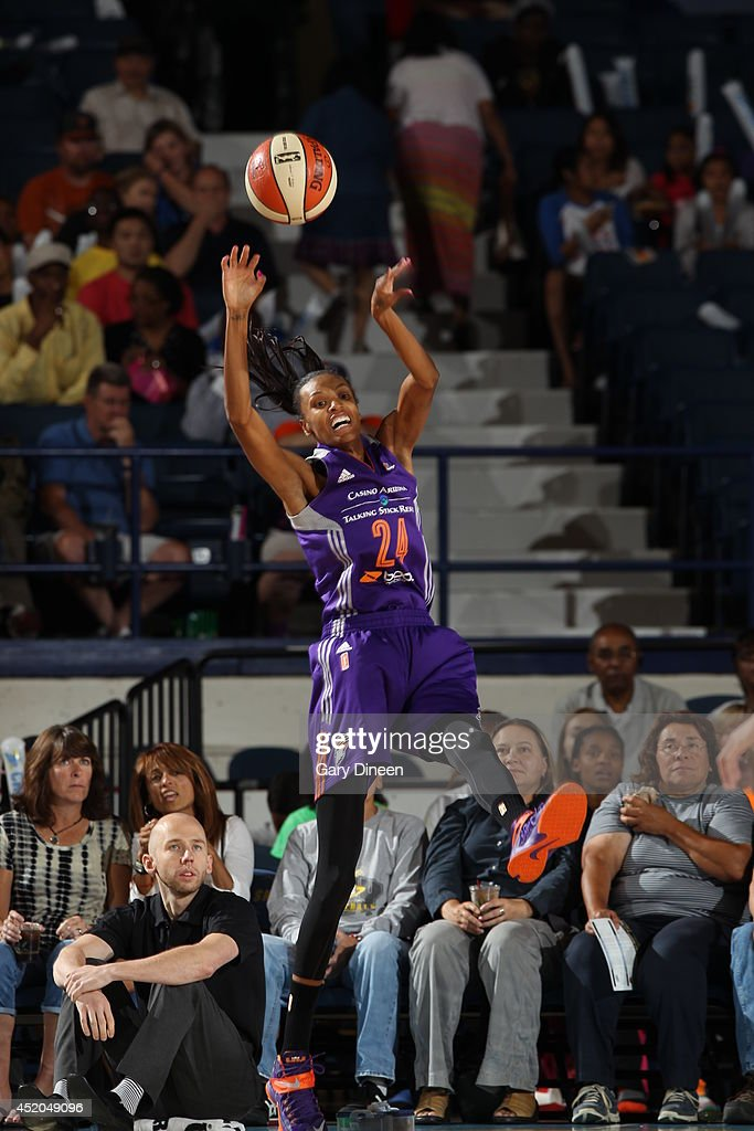 <a gi-track='captionPersonalityLinkClicked' href=/galleries/search?phrase=DeWanna+Bonner&family=editorial&specificpeople=4085058 ng-click='$event.stopPropagation()'>DeWanna Bonner</a> #24 of the Phoenix Mercury passes the ball against the Chicago Sky on July 11, 2014 at the Allstate Arena in Rosemont, Illinois.