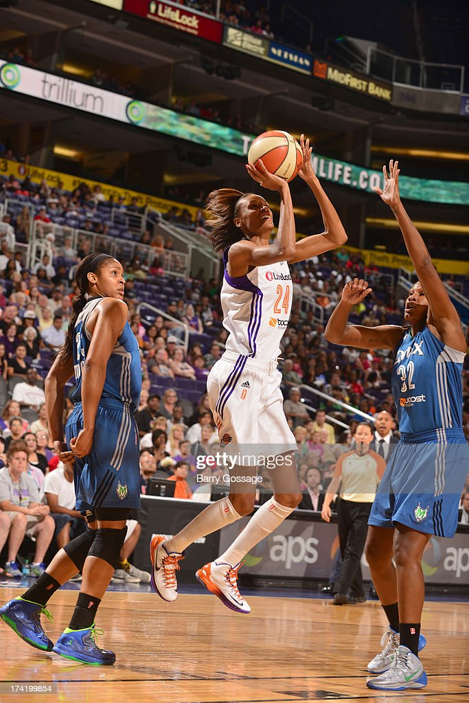 <a gi-track='captionPersonalityLinkClicked' href=/galleries/search?phrase=DeWanna+Bonner&family=editorial&specificpeople=4085058 ng-click='$event.stopPropagation()'>DeWanna Bonner</a> #24 of the Phoenix Mercury shoots against <a gi-track='captionPersonalityLinkClicked' href=/galleries/search?phrase=Rebekkah+Brunson&family=editorial&specificpeople=213521 ng-click='$event.stopPropagation()'>Rebekkah Brunson</a> #32 of the Minnesota Lynx on July 21, 2013 at U.S. Airways Center in Phoenix, Arizona.