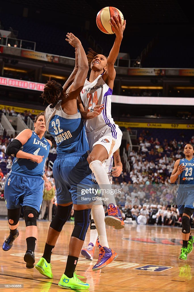 <a gi-track='captionPersonalityLinkClicked' href=/galleries/search?phrase=DeWanna+Bonner&family=editorial&specificpeople=4085058 ng-click='$event.stopPropagation()'>DeWanna Bonner</a> #24 of the Phoenix Mercury shoots against <a gi-track='captionPersonalityLinkClicked' href=/galleries/search?phrase=Rebekkah+Brunson&family=editorial&specificpeople=213521 ng-click='$event.stopPropagation()'>Rebekkah Brunson</a> #32 of the Minnesota Lynx in Game 2 of the Western Conference Finals during 2013 WNBA Playoffs on September 29, 2013 at U.S. Airways Center in Phoenix, Arizona.