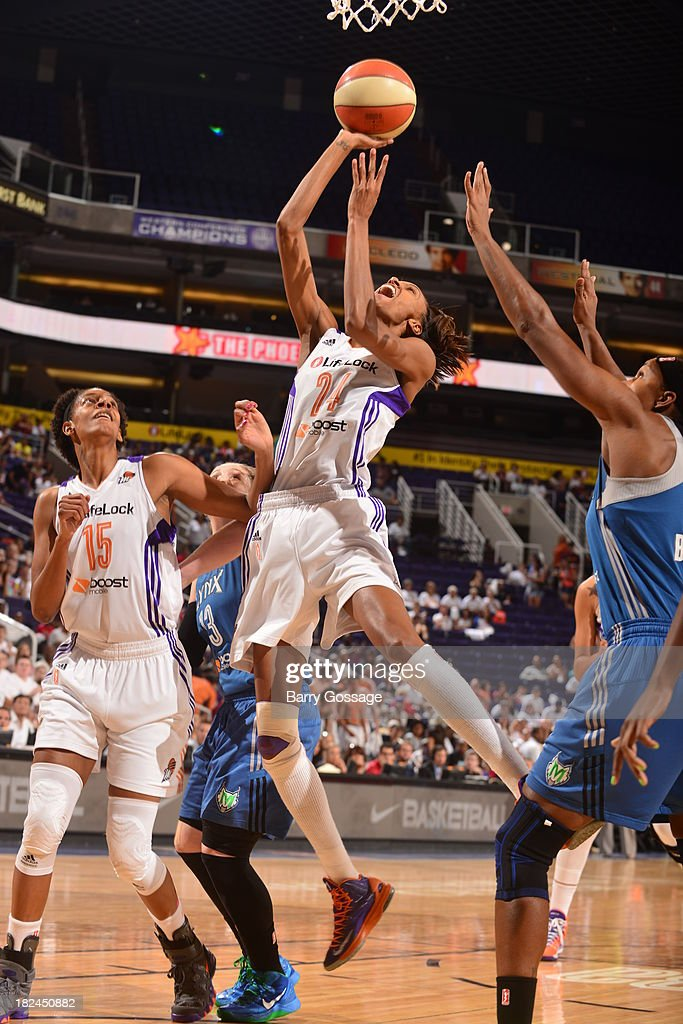 <a gi-track='captionPersonalityLinkClicked' href=/galleries/search?phrase=DeWanna+Bonner&family=editorial&specificpeople=4085058 ng-click='$event.stopPropagation()'>DeWanna Bonner</a> #24 of the Phoenix Mercury shots against <a gi-track='captionPersonalityLinkClicked' href=/galleries/search?phrase=Rebekkah+Brunson&family=editorial&specificpeople=213521 ng-click='$event.stopPropagation()'>Rebekkah Brunson</a> #32 of the Minnesota Lynx in Game 2 of the Western Conference Finals during 2013 WNBA Playoffs on September 29, 2013 at U.S. Airways Center in Phoenix, Arizona.