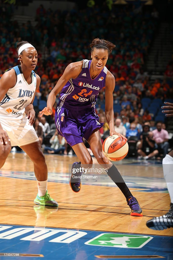 DeWanna Bonner #24 of the the Phoenix Mercury dribbles past Monica Wright #22 of the Minnesota Lynx during the WNBA game on July 24, 2013 at Target Center in Minneapolis, Minnesota.