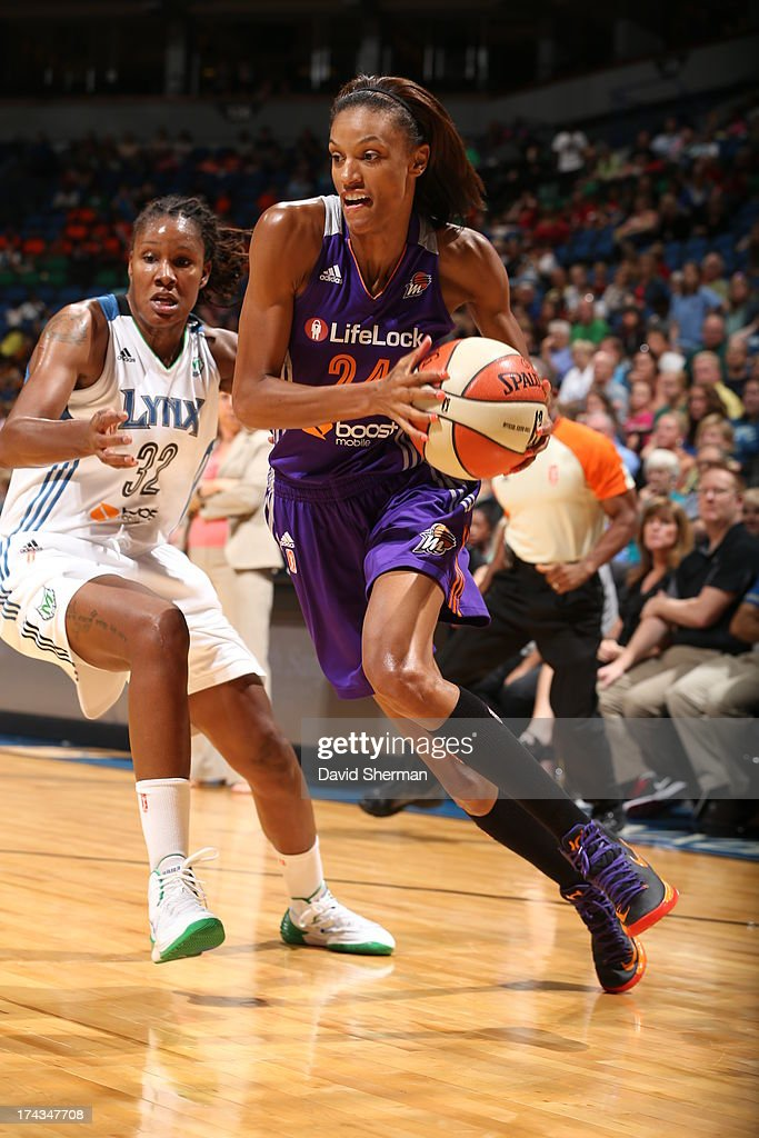 DeWanna Bonner #24 of the the Phoenix Mercury drives to the basket past Rebekkah Brunson #32 of the Minnesota Lynx against VplayerVteam during the WNBA game on July 24, 2013 at Target Center in Minneapolis, Minnesota.