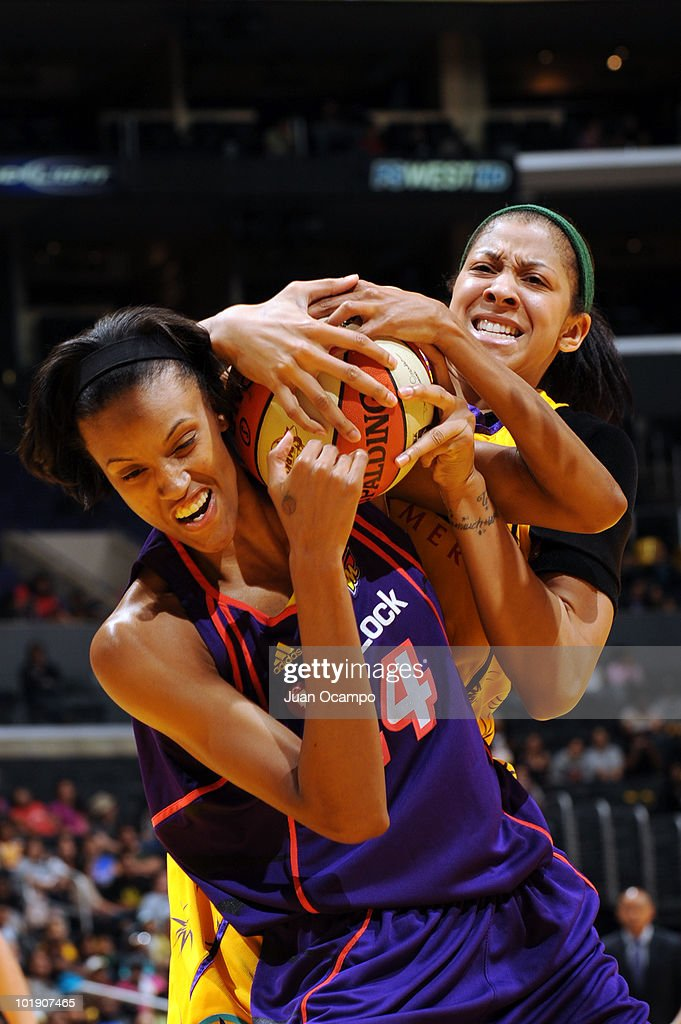DeWanna Bonner#24 of the Phoenix Mercury battles for the ball against Candace Parker of the Los Angeles Sparks on June 8 2010 at Staples Center in...