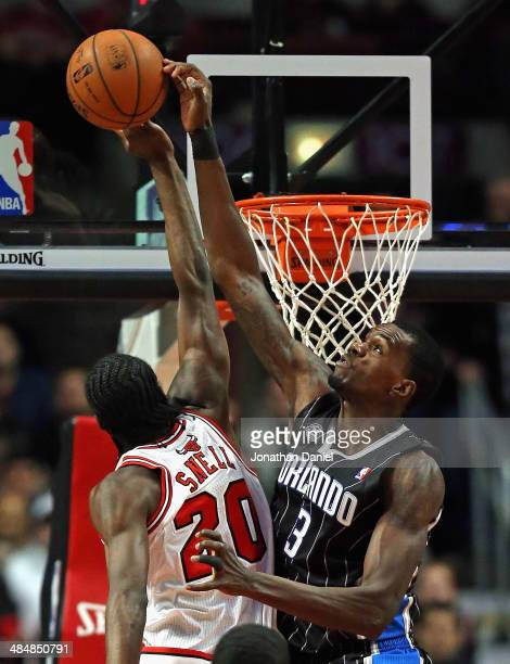 Dewayne Dadmon of the Orlando Magic blocks a shot by Tony Snell of the Chicago Bulls at the United Center on April 14 2014 in Chicago Illinois NOTE...