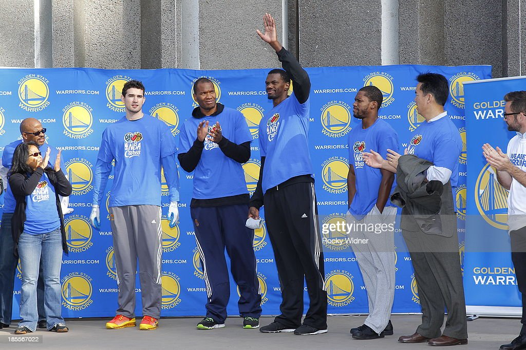 Dewayne Dedmon is introduced to the volunteers who have just helped to clean up McLaren park during Warriors Day Of Service as part of NBA Cares Week Of Service on October 21, 2013 in San Francisco, California.