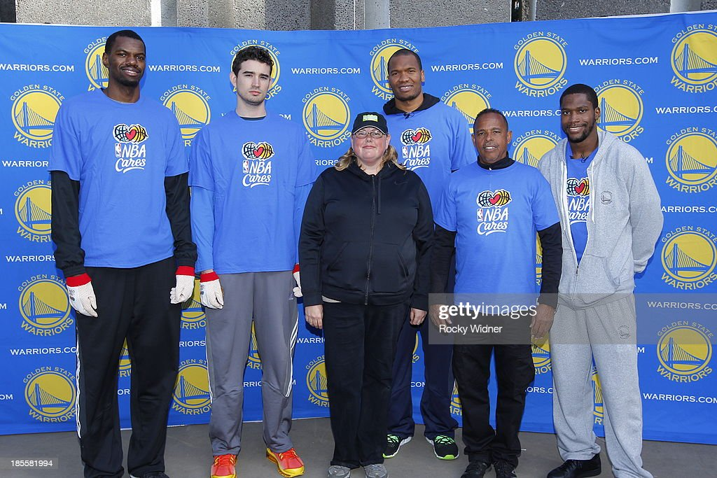 Dewayne Dedmon, Joe Alexander, Marreese Speights, and Toney Douglas pose with members of the San Francisco Parks staff after the clean up of McLaren park during Warriors Day Of Service as part of NBA Cares Week Of Service on October 21, 2013 in San Francisco, California.