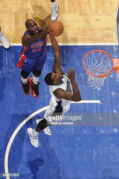 Dewayne Dedmon of the Orlando Magic goes to the basket against Joel Anthony of the Detroit Pistons on December 30 2014 at Amway Center in Orlando...