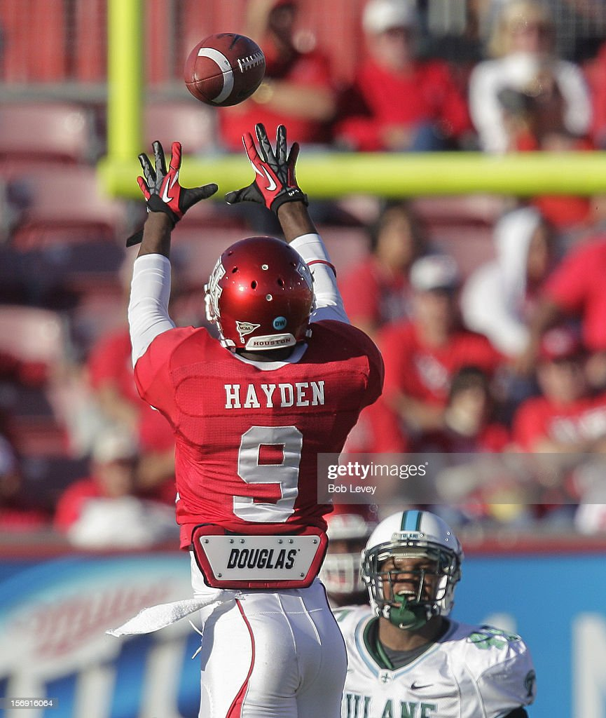 Dewayne Peace #9 of the Houston Cougars goes up for a pass in the second quarter against the Tulane Green Wave at Robertson Stadium on November 24, 2012 in Houston, Texas. Houston defeats Tulane 40-17.