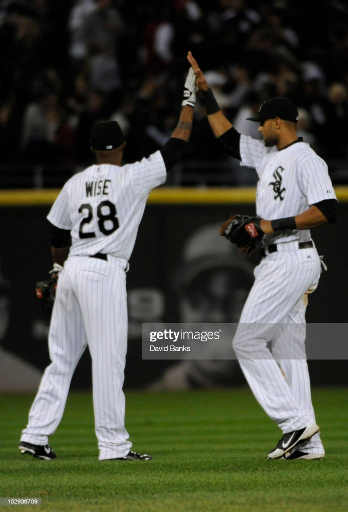 <a gi-track='captionPersonalityLinkClicked' href=/galleries/search?phrase=Dewayne+Wise&family=editorial&specificpeople=704740 ng-click='$event.stopPropagation()'>Dewayne Wise</a> #28 of the Chicago White Sox and <a gi-track='captionPersonalityLinkClicked' href=/galleries/search?phrase=Alex+Rios&family=editorial&specificpeople=224676 ng-click='$event.stopPropagation()'>Alex Rios</a> #51 celebrate the Chicago White Sox victory over the Tampa Bay Rays on September 28, 2012 at U.S. Cellular Field in Chicago, Illinois. The Chicago White Sox defeated the Tampa Bay Rays 3-1.