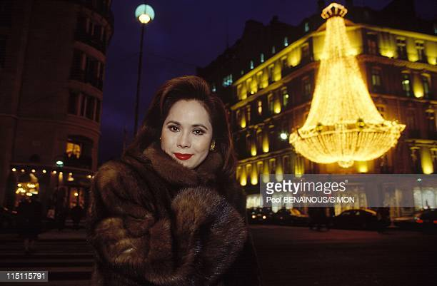 Dewi Sukarno shows her book in Paris France in December 1993 Posing in front of Christian Dior headquarters