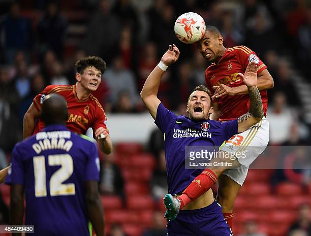 Dexter Blackstock of Nottingam Forest battles with Patrick Bauer of Charlton Athletic during the Sky Bet Championship match between Nottingham Forest...