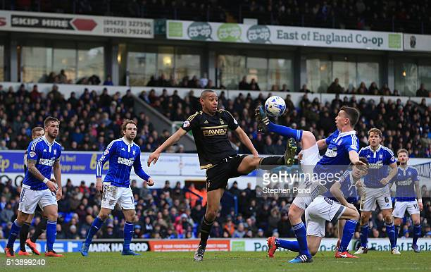 Dexter Blackstock of Nottingham Forest and Kevin Foley of Ipswich Town compete for the ball during the Sky Bet Championship match between Ipswich...