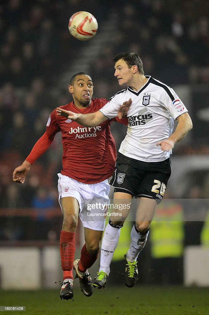 <a gi-track='captionPersonalityLinkClicked' href=/galleries/search?phrase=Dexter+Blackstock&family=editorial&specificpeople=2103833 ng-click='$event.stopPropagation()'>Dexter Blackstock</a> of Nottingham Forest and Tommy Smith of Ipswich compete for a header during the npower Championship match between Nottingham Forest and Ipswich Town at City Ground on March 5, 2013 in Nottingham, England.