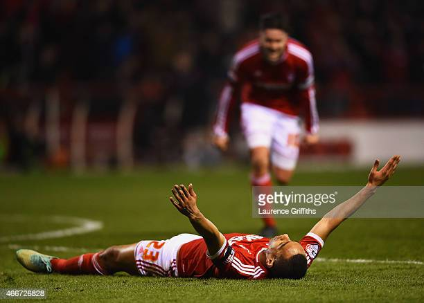 Dexter Blackstock of Nottingham Forest celebrates with Henri Lansbury as he scores their first goal during the Sky Bet Championship match between...