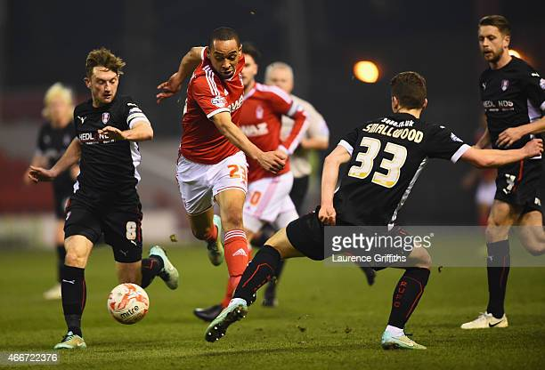 Dexter Blackstock of Nottingham Forest evades Lee Frecklington and Richard Smallwood of Rotherham United during the Sky Bet Championship match...