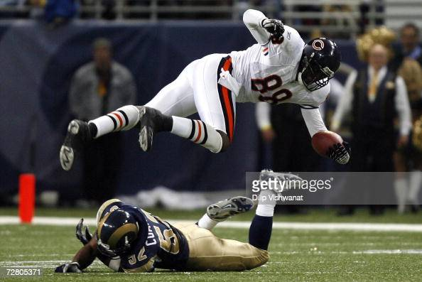 Dexter Coakley of the St Louis Rams tackles Desmond Clark of the Chicago Bears at the Edward Jones Dome December 11 2006 in St Louis Missouri The...
