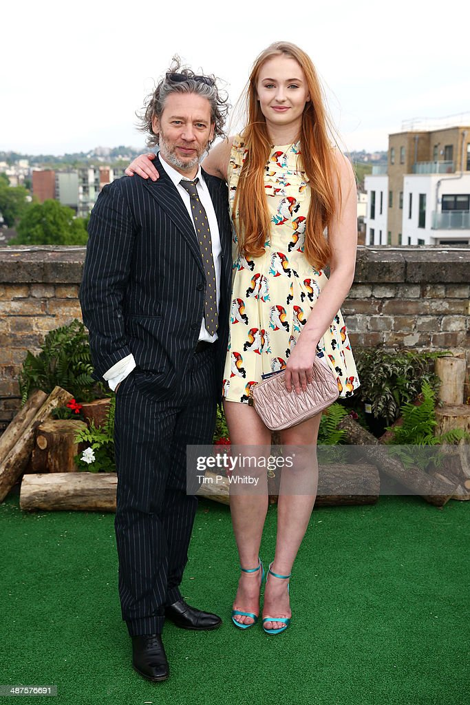Dexter Fletcher and Sophie Turner attend the launch night of the Rooftop Film Club presented by British Airways at The Bussey Building on April 30, 2014 in London, England. The Rooftop Film Club presented by British Airways is a pop up film event where guests use headsets to watch films under the stars, running until September 30.