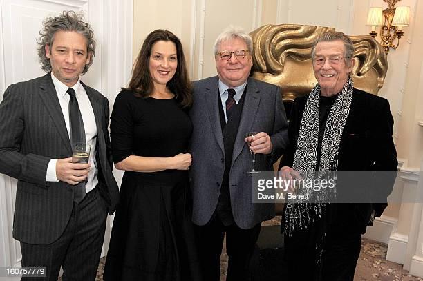 Dexter Fletcher Barbara Broccoli Sir Alan Parker and John Hurt attend a drinks reception awarding Sir Alan Parker the BAFTA Fellowship supported by...