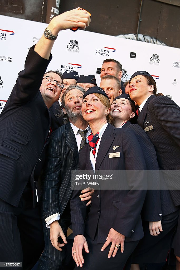 <a gi-track='captionPersonalityLinkClicked' href=/galleries/search?phrase=Dexter+Fletcher&family=editorial&specificpeople=618749 ng-click='$event.stopPropagation()'>Dexter Fletcher</a> (2nd L) poses with British Airways Ambassadors during the launch night of the Rooftop Film Club presented by British Airways at The Bussey Building on April 30, 2014 in London, England. The Rooftop Film Club presented by British Airways is a pop up film event where guests use headsets to watch films under the stars, running until September 30.