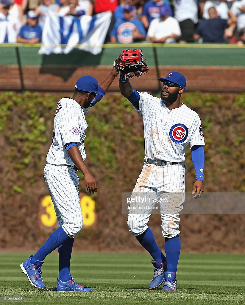 Dexter Fowler #24 (L) and Jason Heyward #22 of the Chicago Cubs celebrate a win over the Washington Nationals at Wrigley Field on May 6, 2016 in Chicago, Illinois. The Cubs defeated the Nationals 8-6.