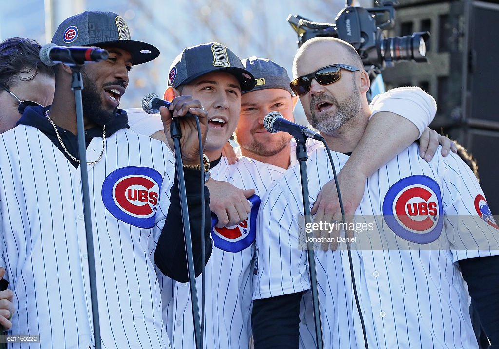 Dexter Fowler, Anthony Rizzo, Jon Lester and David Ross of the Chicago Cubs sing 'Go, Cubs, Go' during the Chicago Cubs victory celebration in Grant Park on November 4, 2016 in Chicago, Illinois. The Cubs won their first World Series championship in 108 years after defeating the Cleveland Indians 8-7 in Game 7.