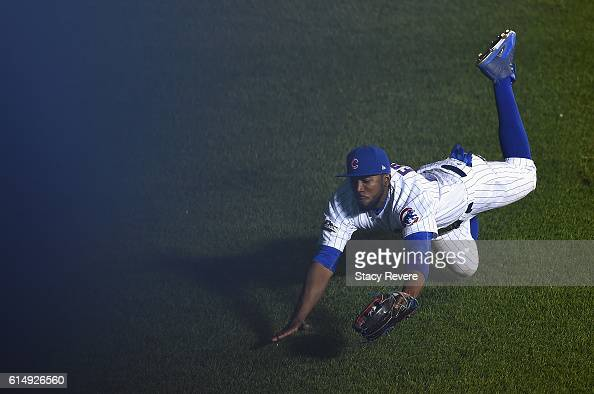 Dexter Fowler of the Chicago Cubs catches a fly ball in the third inning against the Los Angeles Dodgers during game one of the National League...