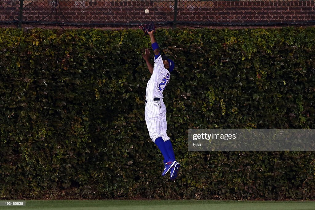 <a gi-track='captionPersonalityLinkClicked' href=/galleries/search?phrase=Dexter+Fowler&family=editorial&specificpeople=4949024 ng-click='$event.stopPropagation()'>Dexter Fowler</a> #24 of the Chicago Cubs catches a pop up fly hit by Yoenis Cespedes #52 of the New York Mets in the third inning during game three of the 2015 MLB National League Championship Series at Wrigley Field on October 20, 2015 in Chicago, Illinois.