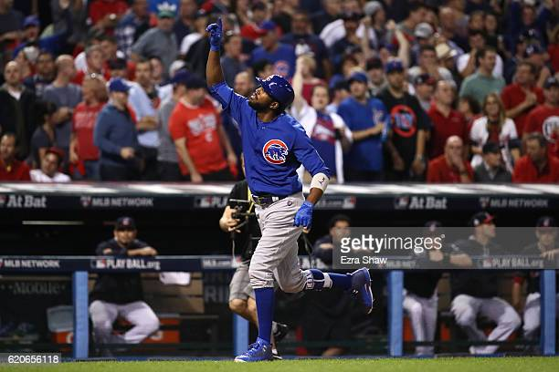 Dexter Fowler of the Chicago Cubs celebrates after hitting a lead off home run in the first inning against the Cleveland Indians in Game Seven of the...