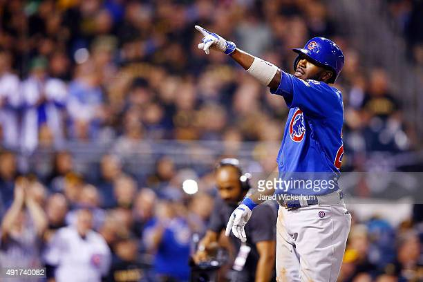 Dexter Fowler of the Chicago Cubs celebrates after hitting a solo home run in the fifth inning during the National League Wild Card game against the...
