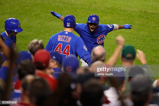 Dexter Fowler of the Chicago Cubs celebrates with Anthony Rizzo after Fowler hits a lead off home run in the first inning against the Cleveland...