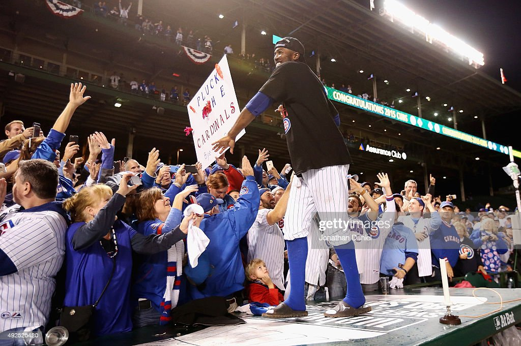Dexter Fowler #24 of the Chicago Cubs celebrates with fans after defeating the St. Louis Cardinals in game four of the National League Division Series to win the NLDS 3-1 at Wrigley Field on October 13, 2015 in Chicago, Illinois. The Chicago Cubs defeat the St. Louis Cardinals with a score of 6 to 4.