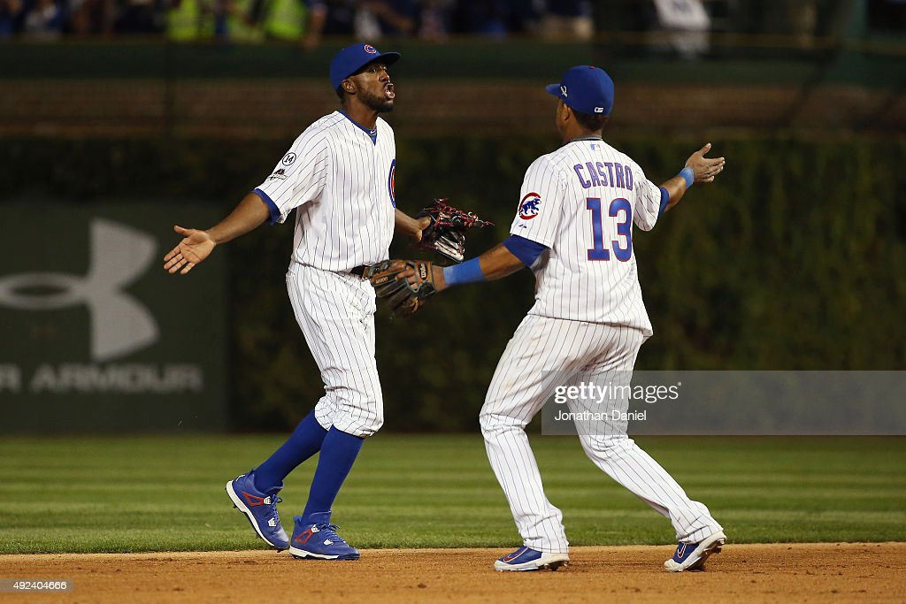 <a gi-track='captionPersonalityLinkClicked' href=/galleries/search?phrase=Dexter+Fowler&family=editorial&specificpeople=4949024 ng-click='$event.stopPropagation()'>Dexter Fowler</a> #24 of the Chicago Cubs celebrates with <a gi-track='captionPersonalityLinkClicked' href=/galleries/search?phrase=Starlin+Castro&family=editorial&specificpeople=5970945 ng-click='$event.stopPropagation()'>Starlin Castro</a> #13 of the Chicago Cubs after defeating the St. Louis Cardinals in game three of the National League Division Series at Wrigley Field on October 12, 2015 in Chicago, Illinois. The Chicago Cubs defeat the St. Louis Cardinals with a score of 8 to 6.