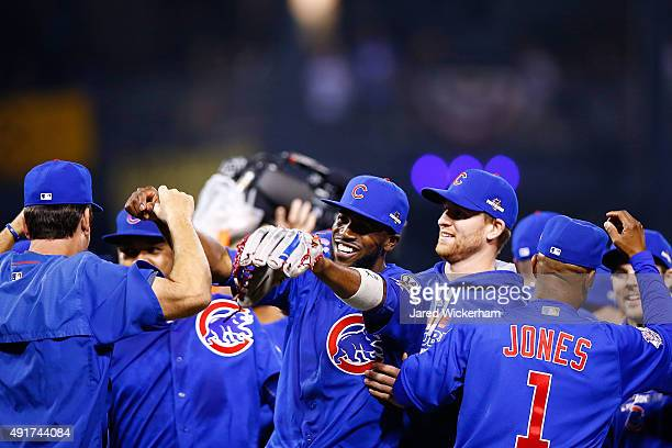 Dexter Fowler of the Chicago Cubs celebrates with teammates after defeating the Pittsburgh Pirates to win the National League Wild Card game at PNC...