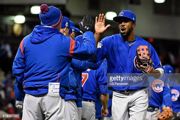 Dexter Fowler of the Chicago Cubs celebrates with teammates after defeating the Cleveland Indians 51 in Game 2 of the 2016 World Series at...