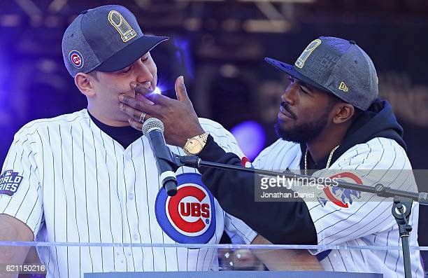 Dexter Fowler of the Chicago Cubs checks for tears after Anthony Rizzo gets choked up speaking to the crowd during the Chicago Cubs victory...