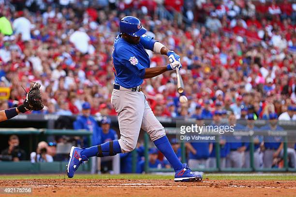 Dexter Fowler of the Chicago Cubs hits an RBI single in the second inning against the St Louis Cardinals during game two of the National League...