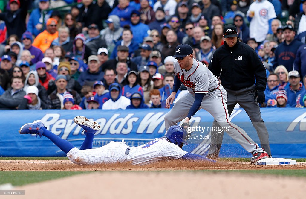 <a gi-track='captionPersonalityLinkClicked' href=/galleries/search?phrase=Dexter+Fowler&family=editorial&specificpeople=4949024 ng-click='$event.stopPropagation()'>Dexter Fowler</a> #24 of the Chicago Cubs is doubled up at first base by <a gi-track='captionPersonalityLinkClicked' href=/galleries/search?phrase=Freddie+Freeman&family=editorial&specificpeople=5743987 ng-click='$event.stopPropagation()'>Freddie Freeman</a> #5 of the Atlanta Braves in the sixth inning at Wrigley Field on April 29, 2016 in Chicago, Illinois.