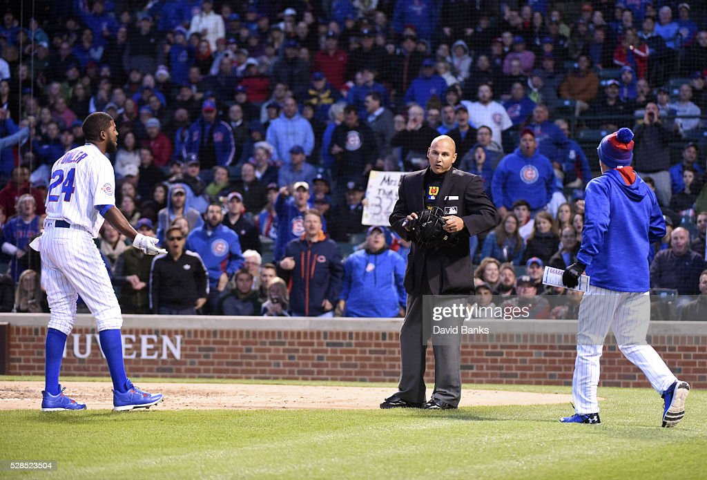 <a gi-track='captionPersonalityLinkClicked' href=/galleries/search?phrase=Dexter+Fowler&family=editorial&specificpeople=4949024 ng-click='$event.stopPropagation()'>Dexter Fowler</a> #24 of the Chicago Cubs is thrown out of the game by umpire Vic Carapazza #19 as <a gi-track='captionPersonalityLinkClicked' href=/galleries/search?phrase=Joe+Maddon&family=editorial&specificpeople=568433 ng-click='$event.stopPropagation()'>Joe Maddon</a> manger of the Chicago Cubs comes out to argue during the third inningin a game against the Washington Nationals on May 5, 2016 at Wrigley Field in Chicago, Illinois.