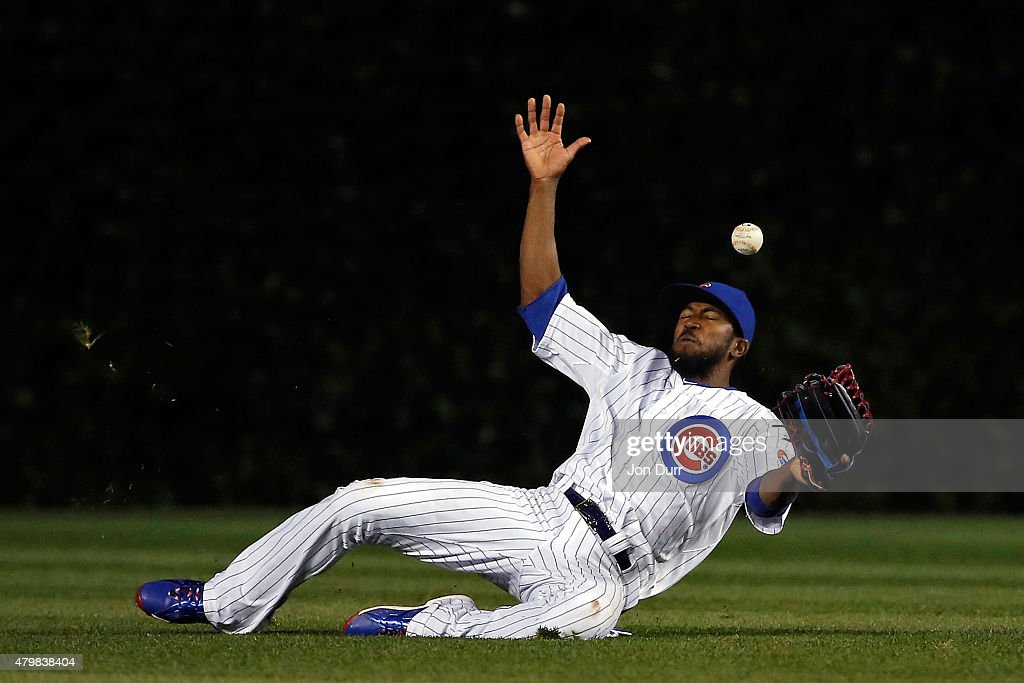 <a gi-track='captionPersonalityLinkClicked' href=/galleries/search?phrase=Dexter+Fowler&family=editorial&specificpeople=4949024 ng-click='$event.stopPropagation()'>Dexter Fowler</a> #24 of the Chicago Cubs is unable to make a catch against the St. Louis Cardinals during the ninth inning during game two of a double header at Wrigley Field on July 7, 2015 in Chicago, Illinois.