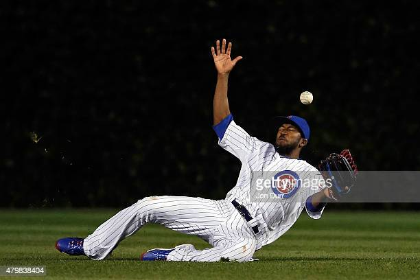 Dexter Fowler of the Chicago Cubs is unable to make a catch against the St Louis Cardinals during the ninth inning during game two of a double header...