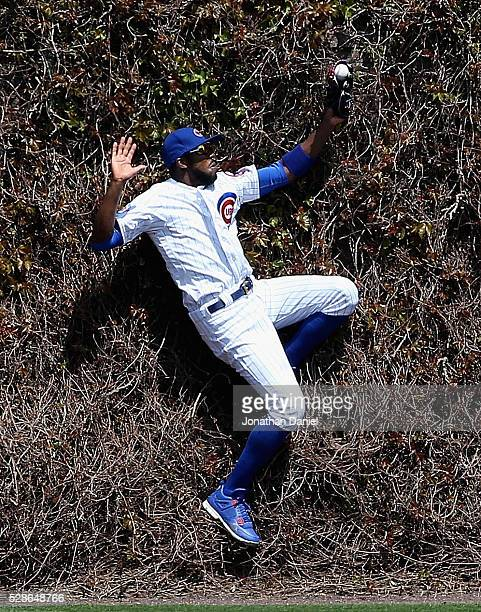 Dexter Fowler of the Chicago Cubs makes a catch at the wall of a ball hit by Ben Revere of the Washington Nationals in the 2nd inning at Wrigley...
