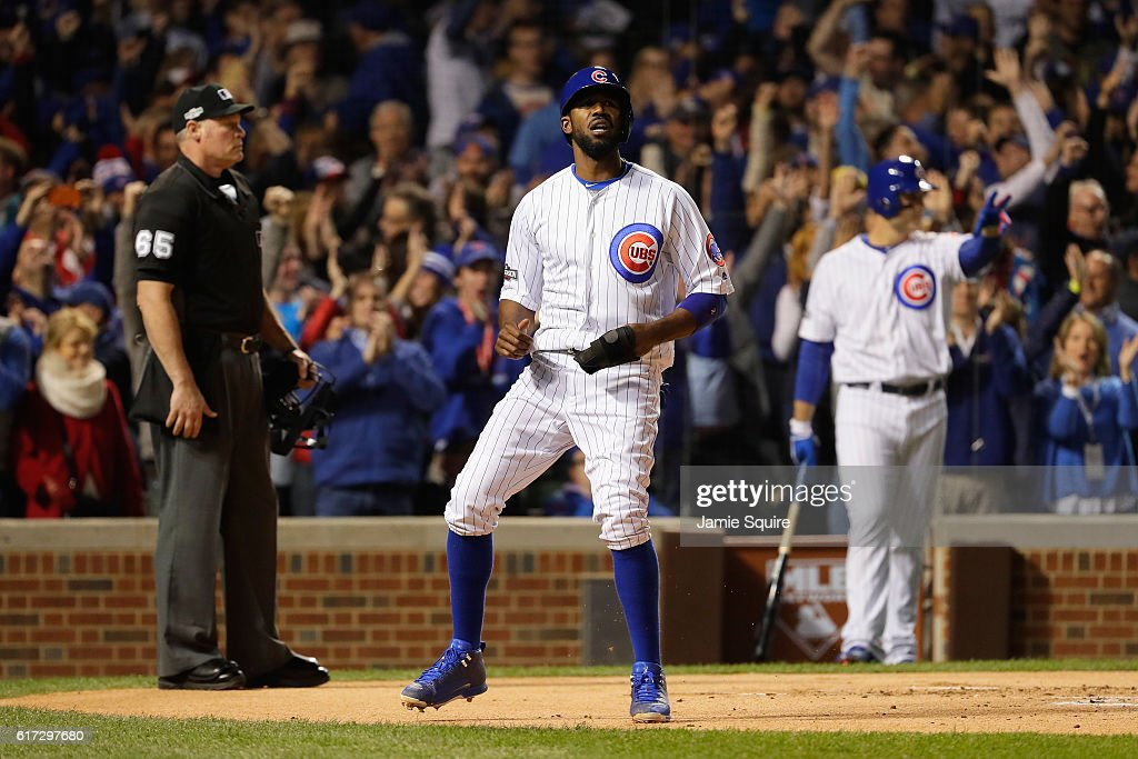Dexter Fowler #24 of the Chicago Cubs reacts after scoring a run on an RBI single hit by Kris Bryant #17 (not pictured) in the first inning against the Los Angeles Dodgers during game six of the National League Championship Series at Wrigley Field on October 22, 2016 in Chicago, Illinois.