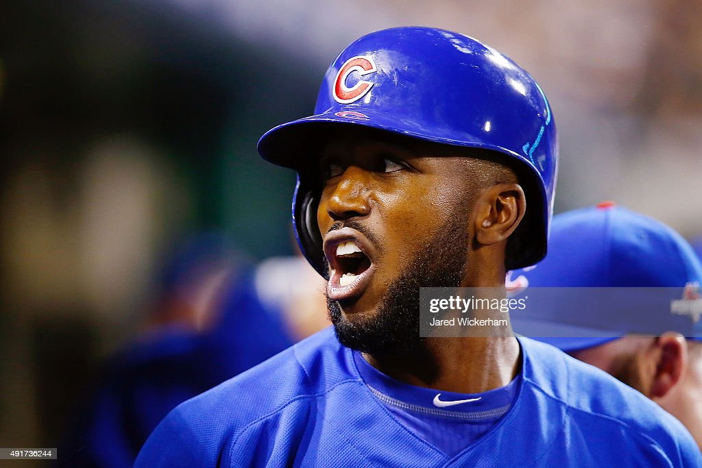 <a gi-track='captionPersonalityLinkClicked' href=/galleries/search?phrase=Dexter+Fowler&family=editorial&specificpeople=4949024 ng-click='$event.stopPropagation()'>Dexter Fowler</a> #24 of the Chicago Cubs reacts in the dugout after scoring a run on an RBI single by Kyle Schwarber #12 of the Chicago Cubs (not pictured) in the first inning during the National League Wild Card game against the Pittsburgh Pirates at PNC Park on October 7, 2015 in Pittsburgh, Pennsylvania.