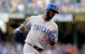 Dexter Fowler of the Chicago Cubs rounds the bases after hitting a home run in the first inning against the Milwaukee Brewers at Miller Park on July...