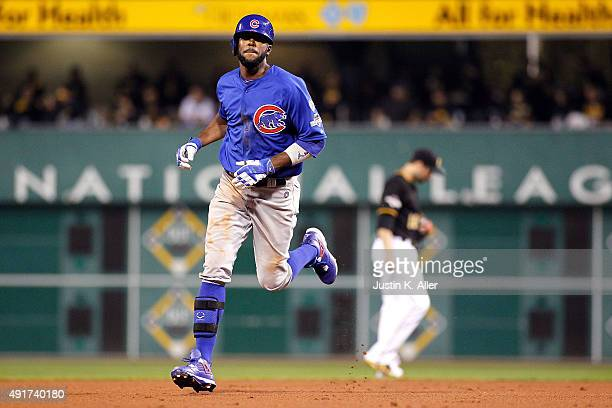 Dexter Fowler of the Chicago Cubs runs the bases after hitting a solo home run in the fifth inning during the National League Wild Card game against...