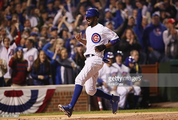 Dexter Fowler of the Chicago Cubs scores a run in the first inning against the Cleveland Indians in Game Four of the 2016 World Series at Wrigley...