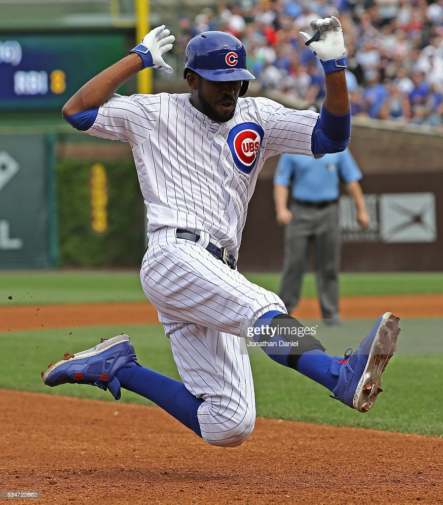 <a gi-track='captionPersonalityLinkClicked' href=/galleries/search?phrase=Dexter+Fowler&family=editorial&specificpeople=4949024 ng-click='$event.stopPropagation()'>Dexter Fowler</a> #24 of the Chicago Cubs slides into third base with a triple in the 4th inning against the Philadelphia Phillies at Wrigley Field on May 27, 2016 in Chicago, Illinois.