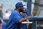 Dexter Fowler of the Chicago Cubs waits for his turn during batting practice before the game against the Milwaukee Brewers at Miller Park on July 22...