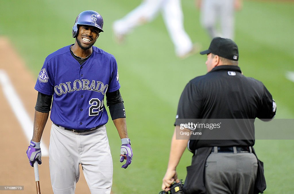 <a gi-track='captionPersonalityLinkClicked' href=/galleries/search?phrase=Dexter+Fowler&family=editorial&specificpeople=4949024 ng-click='$event.stopPropagation()'>Dexter Fowler</a> #24 of the Colorado Rockies argues with home plate umpire Sam Holbrook after a called third strike in the fifth inning against the Washington Nationals at Nationals Park on June 21, 2013 in Washington, DC.