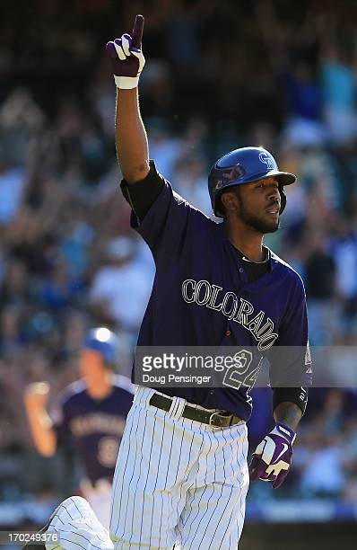 Dexter Fowler of the Colorado Rockies celebrates as he hits the game winning single off of Joe Thatcher of the San Diego Padres to score DJ LeMahieu...